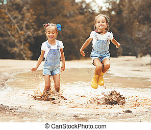 58986ab0f3 Funny funny happy children in bathing suits jumping on... stock ...