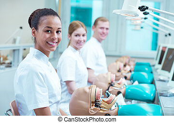 Happy future dentists at school - Three young happy future ...