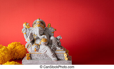 Happy Ganesh Chaturthi festival, Lord Ganesha statue with beautiful texture on red background, Ganesh is hindu god of Success.