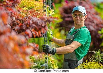 Happy Garden Store Worker