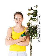 Happy gardener using pruning scissors.
