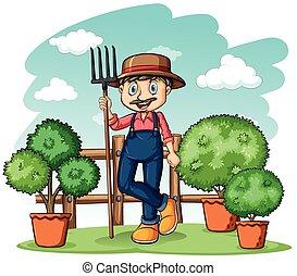 Happy gardener with a rake