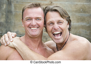 Happy gay couple cuddling. - Happy gay couple cuddling and...