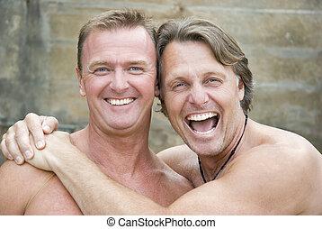 Happy gay couple cuddling.