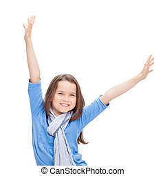 A young happy girl with her arms raised