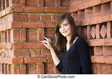 Happy Girl Against Brick Wall