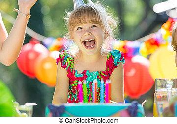 Happy girl and birthday cake