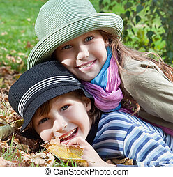 Happy girl and boy enjoying autumn season