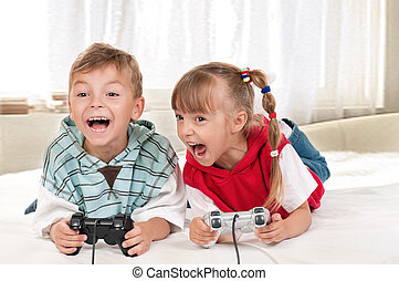 Happy girl and boy playing a video game
