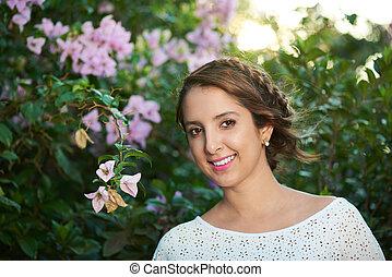 happy girl around flowers