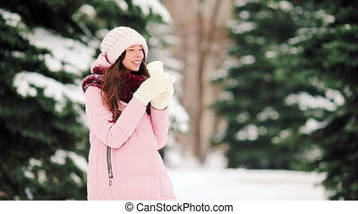 Happy girl at snow weather outdoors on beautiful cold day