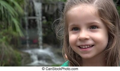 Happy Girl at Waterfall