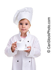 Happy girl chef white uniform isolated on white background. Holding the white cup with a saucer. Portrait image