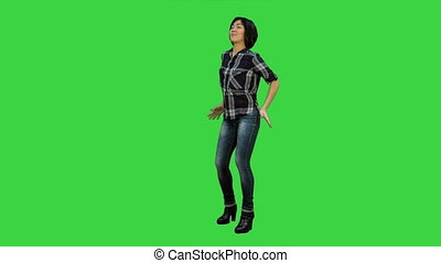 Happy girl dancing and listening to the music on a Green Screen, Chroma Key