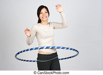 hula hoop - happy girl dooing hula hoop