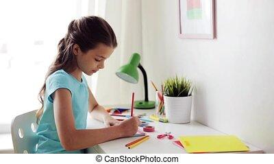 happy girl drawing at home