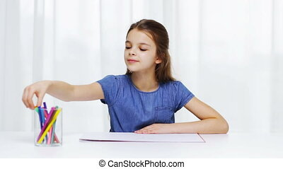 happy girl drawing with felt-tip pencils at home - people,...