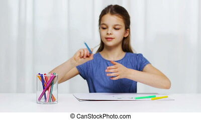 happy girl drawing with felt-tip pens at home - people,...