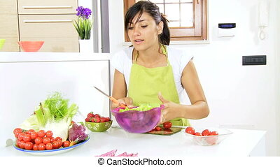 Happy girl eating fresh salad
