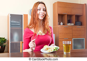 girl eating potatoes at home