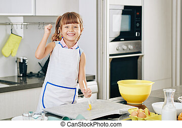 Happy girl enjoying baking