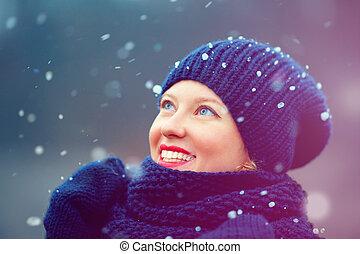 happy girl enjoying winter snow outdoors