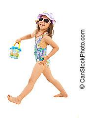 Happy girl going to beach