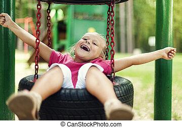 Happy girl having fun on playground