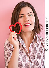 Happy girl holding a heart - Beautiful smiling girl holding...
