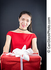 Happy girl holding a present box