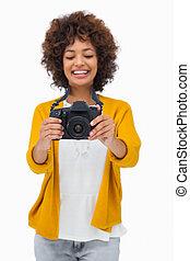 Happy girl holding digital camera