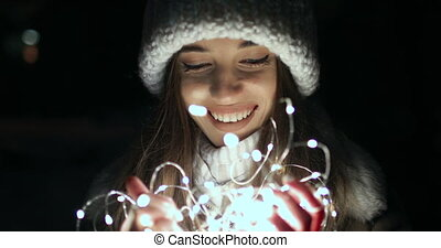 Happy Girl Holding Small Decoration Lights