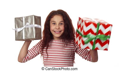 Happy girl holding two Christmas gifts in her hands