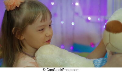 Happy girl hugging a teddy bear. Present for New Year for child