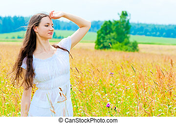 happy girl in field with flowers