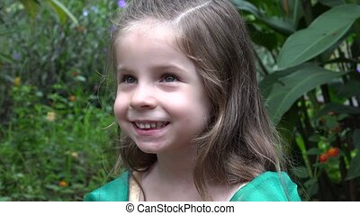 Happy Girl in Flower Garden
