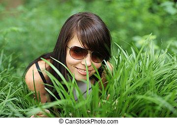 Happy girl in green grass
