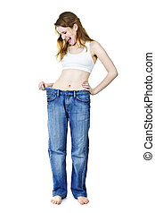 Happy girl in jeans after losing weight - Excited fit young...