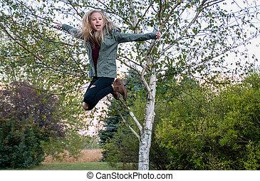 happy girl in midair jump - happy Caucasian girl in midair...