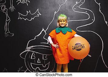Happy girl in pumpkin costume