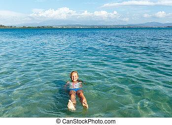 Happy girl in sea