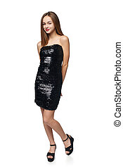 Happy girl in sequin dress over white - Full length girl in...