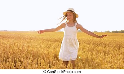 happy girl in straw hat on cereal field in summer - nature,...