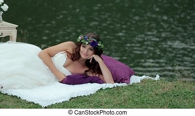 Happy Girl in White Dress Lying on the Blanket