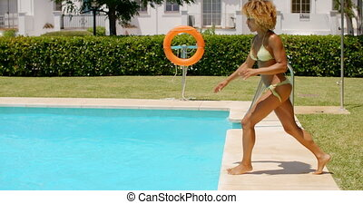 Happy Girl Jumping into Swimming Pool