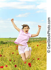 happy girl jumping on field