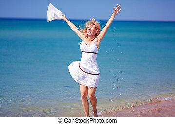 happy girl jumping on summer beach