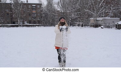 Happy girl jumping over blue sky and snow background