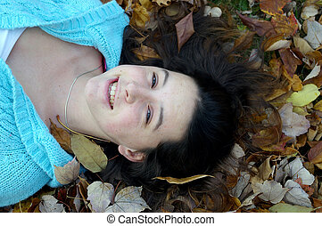happy girl laying down - girl laying down in leaves