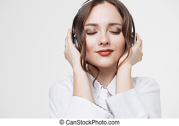 Happy Girl Listen Music in White Headphones and Smiling -...